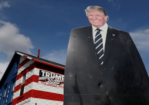 A 14-foot cutout of U.S. President Donald Trump stands on the front lawn of the self-proclaimed 'Trump House' in Youngstown, Pennsylvania, U.S., October 21, 2020.