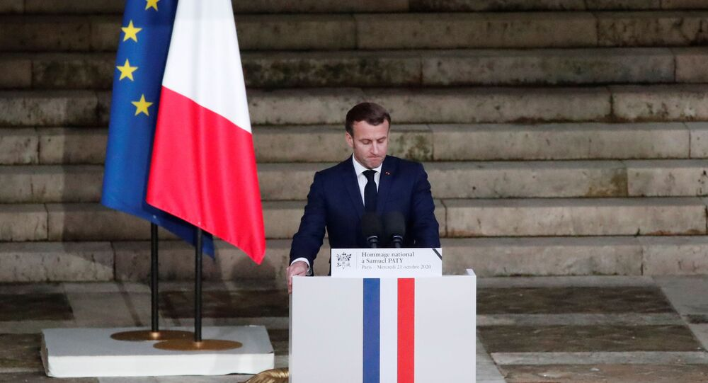 French President Emmanuel Macron delivers his speech in front of the coffin of slain teacher Samuel Paty during a national memorial event, in Paris, France October 21, 2020.