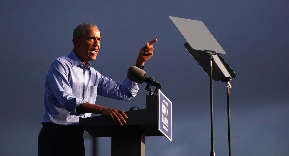 Former U.S. President Barack Obama gestures as he campaigns on behalf of Democratic presidential nominee and his former Vice President Joe Biden in Philadelphia, Pennsylvania, U.S., October 21, 2020.