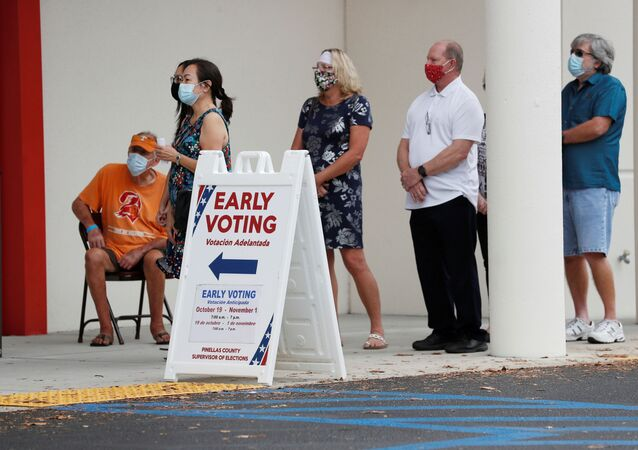 People line up at the Supervisor of Elections Office polling station as early voting begins in Pinellas County ahead of the election in Largo, Florida, U.S. October 21, 2020