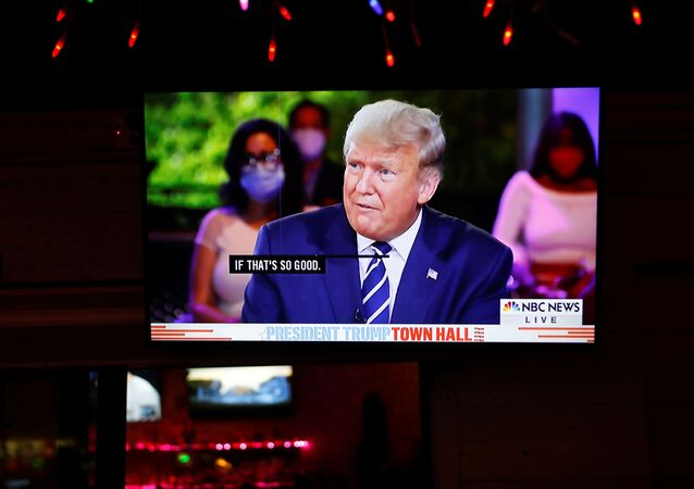The town hall event of U.S. President Donald Trump is seen on a television monitor at Luv Child restaurant ahead of the election in Tampa, Florida, U.S. October 15, 2020.