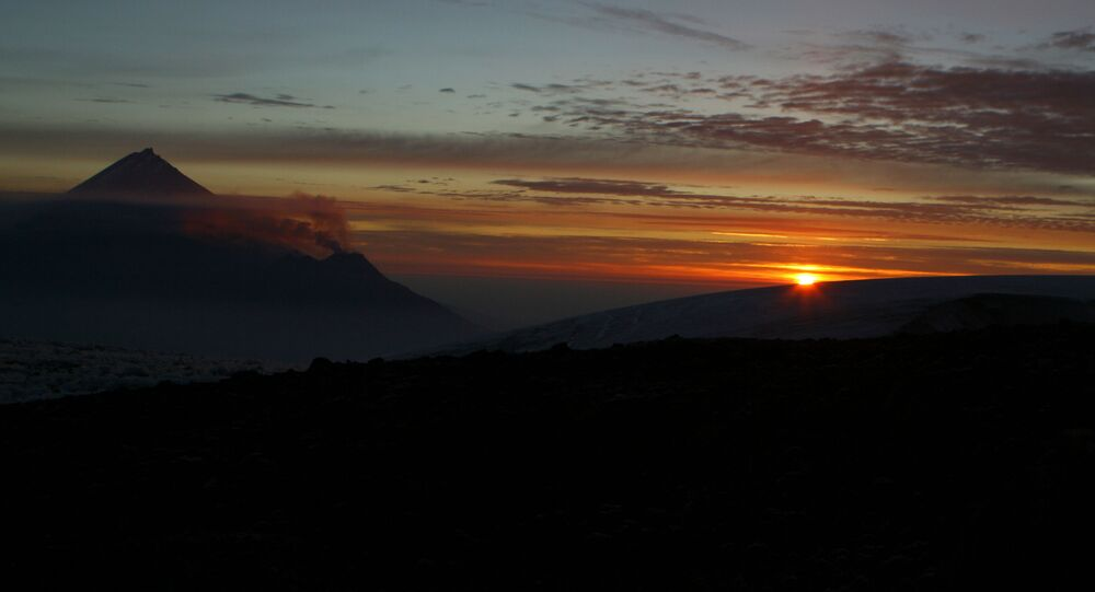Views of Kamchatka. Sunrise. From left: Kamen and Bezymyanny volcanoes