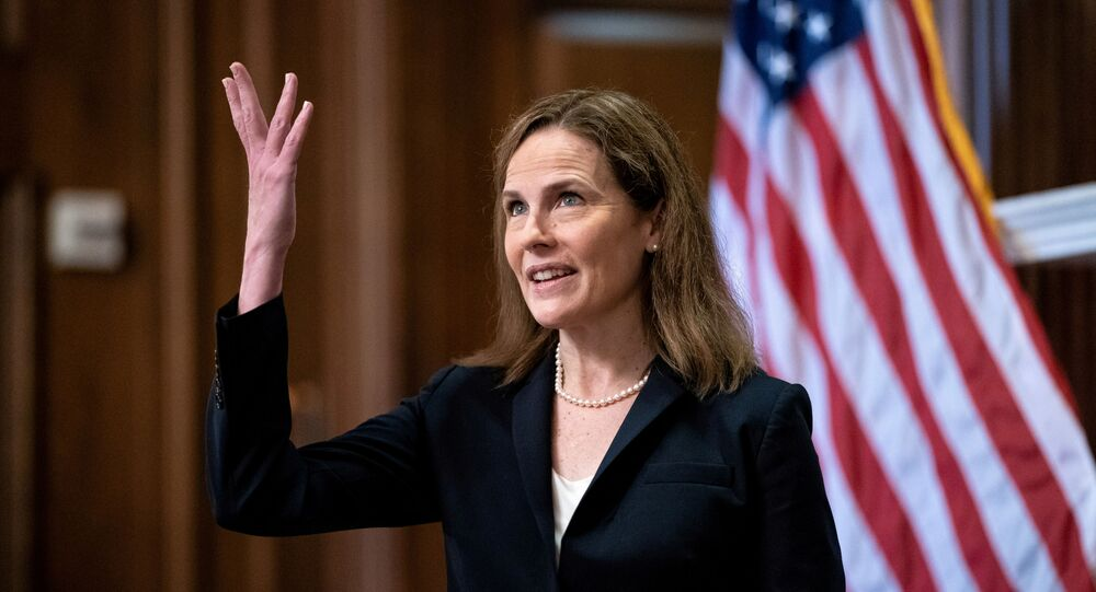 FILE PHOTO: Judge Amy Coney Barrett, U.S. President Donald Trump's Nominee for Supreme Court, gestures during a photo before a meeting with Senator Roy Blunt (R-Mo) on Capitol Hill in Washington DC, U.S. October 21, 2020