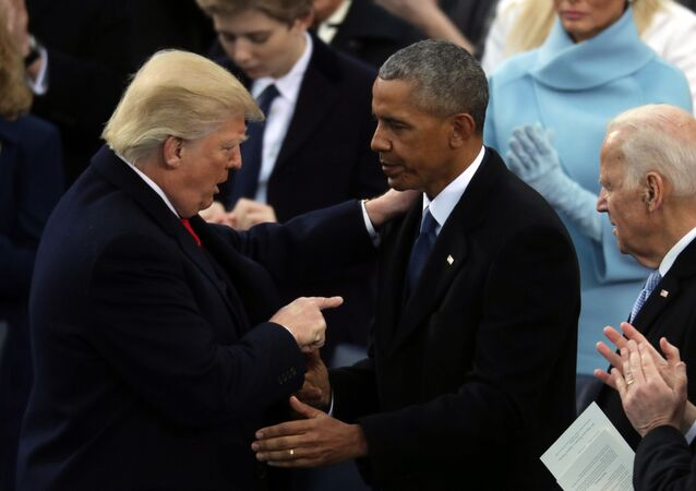 Former U.S. President Barack Obama (C) and former Vice President Joe Biden (R) congratulate U.S. President Donald Trump after he took the oath of office on the West Front of the U.S. Capitol on January 20, 2017 in Washington