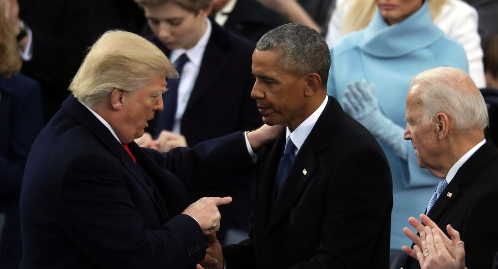 Former US president Barack Obama (C) and former vice-president Joe Biden (R) congratulate US President Donald Trump after he took the oath of office on the West Front of the Capitol on 20 January 2017 in Washington, DC.