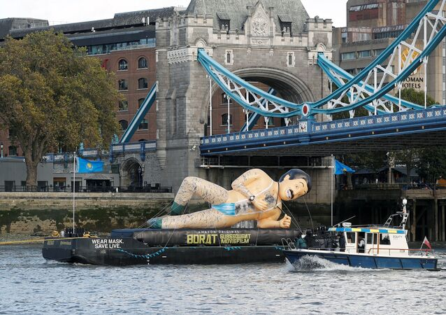 An inflatable Borat character promoting movie Borat Subsequent Moviefilm is carried along the River Thames from Tower Bridge aboard a barge, in London, Britain October 22, 2020.