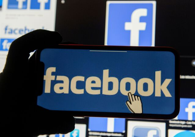 The Facebook logo is displayed on a mobile phone in this picture illustration taken 2 December 2019.