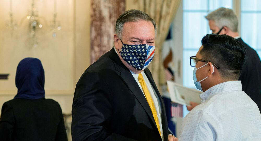 U.S. Secretary of State Mike Pompeo congratulates a new American during a naturalization ceremony at the State Department in Washington, U.S. October 22, 2020.