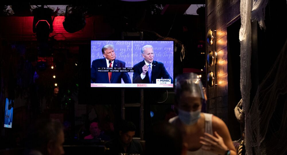 People watch the second 2020 US presidential campaign debate between Democratic presidential nominee Joe Biden and  President Donald Trump at The Abbey Bar during the coronavirus disease (COVID-19) outbreak in West Hollywood, California, 22 October 2020.