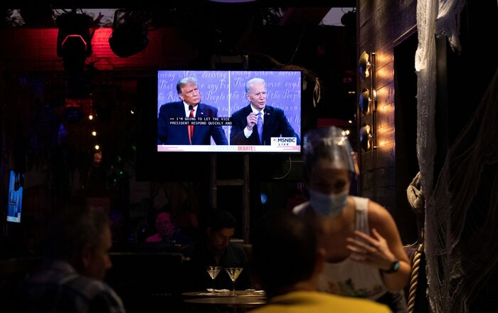 People watch the second 2020 presidential campaign debate between Democratic presidential nominee Joe Biden and U.S. President Donald Trump at The Abbey Bar during the outbreak of the coronavirus disease (COVID-19), in West Hollywood, California, U.S., October 22, 2020.