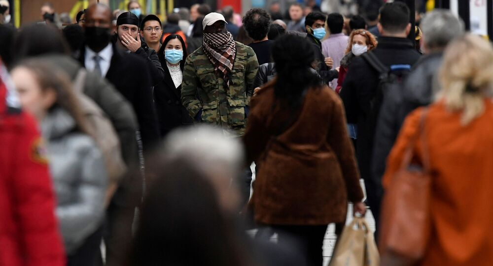 FILE PHOTO: Shoppers walk along Oxford Street, in the centre of London's retail shopping area, amid the spread of the coronavirus disease (COVID-19) in London, Britain, October 16, 2020