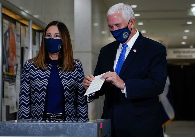 U.S. Vice President Mike Pence, stands with his wife, Karen, while casting his ballot for the upcoming election at a polling station in Indianapolis, Indiana, U.S. October 23, 2020