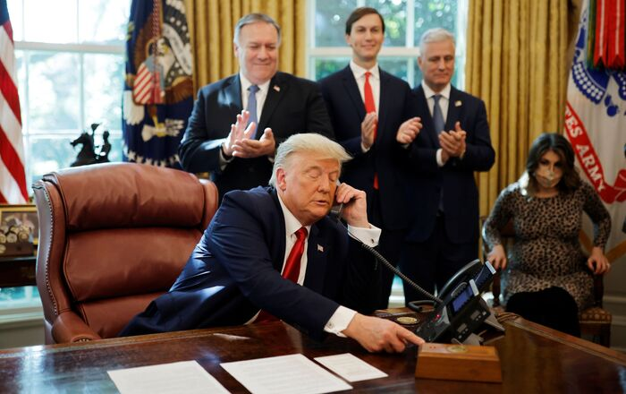 Secretary of State Mike Pompeo and White House senior advisor Jared Kushner applaud as U.S. President Donald Trump is seen on the phone with leaders of Israel and Sudan speaking about the decision to rescind Sudan's designation as a state sponsor of terrorism, in the Oval Office at the White House in Washington, U.S., October 23, 2020. REUTERS/Carlos Barria