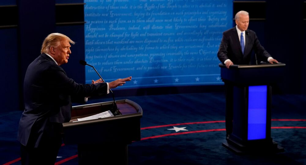 U.S. President Donald Trump answers a question as Democratic presidential candidate former Vice President Joe Biden listens during the final presidential debate at the Curb Event Center at Belmont University in Nashville, Tennessee, U.S