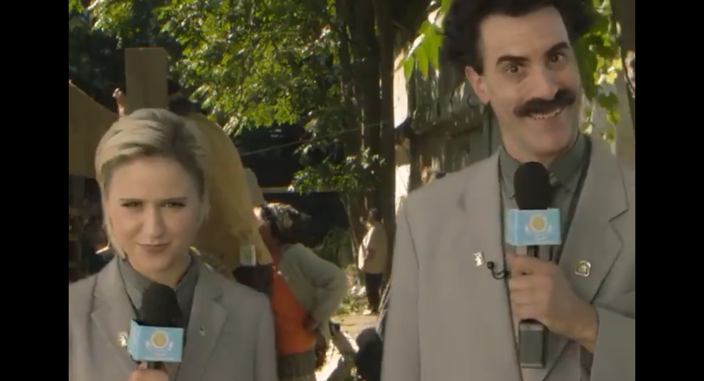 A screenshot from a video posted on the Twitter account of 'Borat Sagdiyev', the satirical fictional character played by British actor and comedian Sacha Baron Cohen, showing Borat and Bulgarian actress Mara Bakalova, who plays his daughter in the newly-released movie 'Borat Subsequent Moviefilm'.