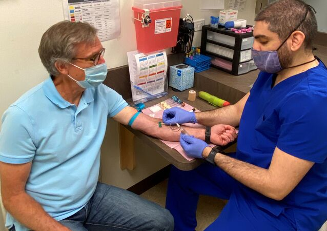 Atlanta resident Norman Hulme, 65, prepares to have his blood drawn as part of a Phase 1 clinical trial for a coronavirus disease (COVID-19) vaccine mRNA-1273 at Emory University's Hope Clinic in Atlanta, Georgia, U.S. May 4, 2020.