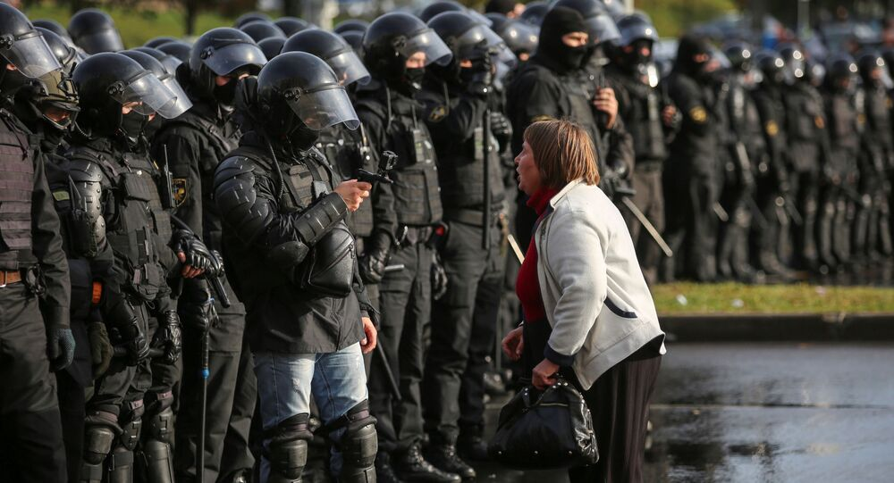 An opposition supporter argues with a police officer during an opposition rally to reject the presidential election results in Minsk, Belarus October 4, 2020.