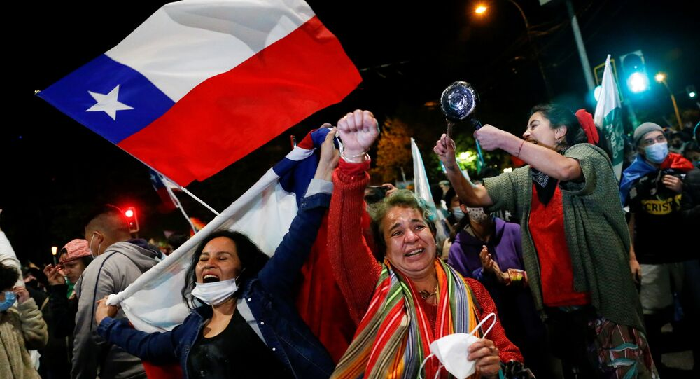 Supporters of the I Approve option react after hearing the results of the referendum on a new Chilean constitution in Valparaiso, Chile, October 25, 2020.