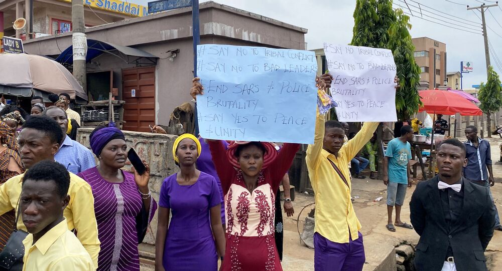 Worshippers take part in a protest calling for peace and unity after attending a Sunday service, as Nigeria's Lagos state eases a round-the-clock curfew imposed in response to protests against alleged police brutality, after days of unrest, in Lagos, Nigeria October 25, 2020