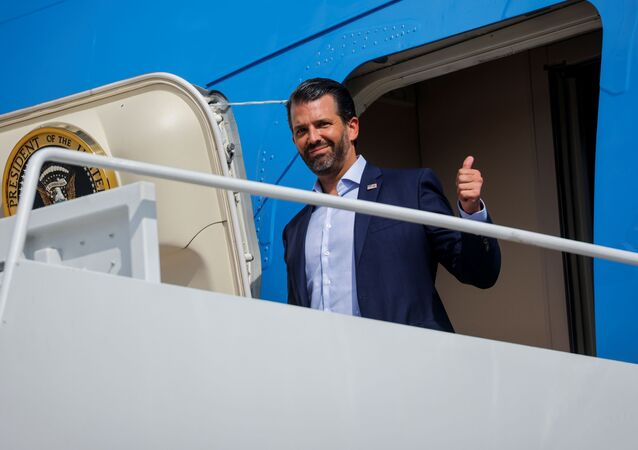 Donald Trump Jr boards Air Force One at Joint Base Andrews, Maryland, US, as he departs Washington with his father, US President Donald Trump, to participate in the first presidential debate with Democratic presidential nominee Joe Biden in Cleveland, Ohio