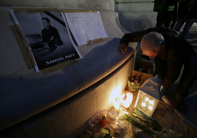 People gather to pay homage to Samuel Paty, the French teacher who was beheaded on the streets of the Paris suburb of Conflans-Sainte-Honorine, as part of a national tribute, in Nice, France, October 21, 2020