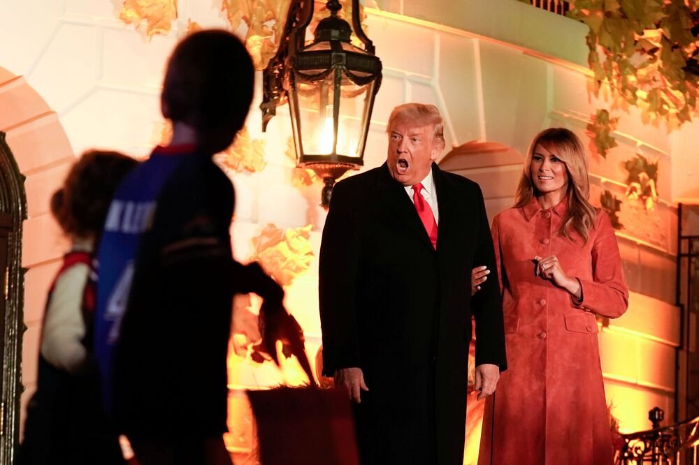 US President Donald Trump responds to a guest as he and Melania host a Halloween event at the White House in Washington, US, 25 October 2020.