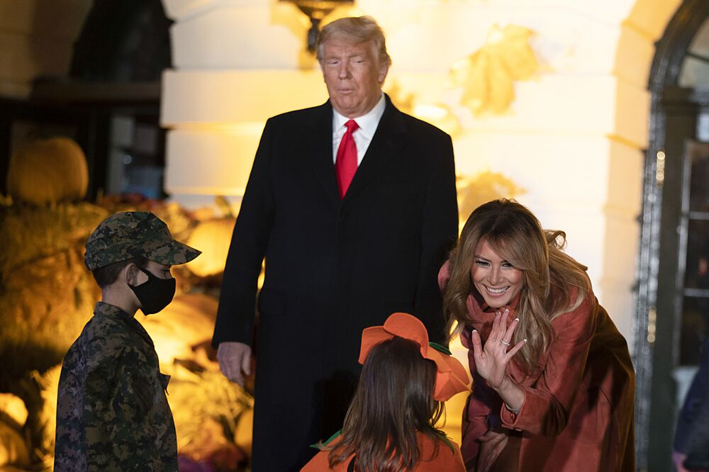 President Donald Trump and first lady Melania Trump greet guests on the south lawn on 25 October 2020. To ensure the health and safety of guests and staff during the festivities, extra measures such as facemasks, social distancing, and hand-sanitiser were introduced.