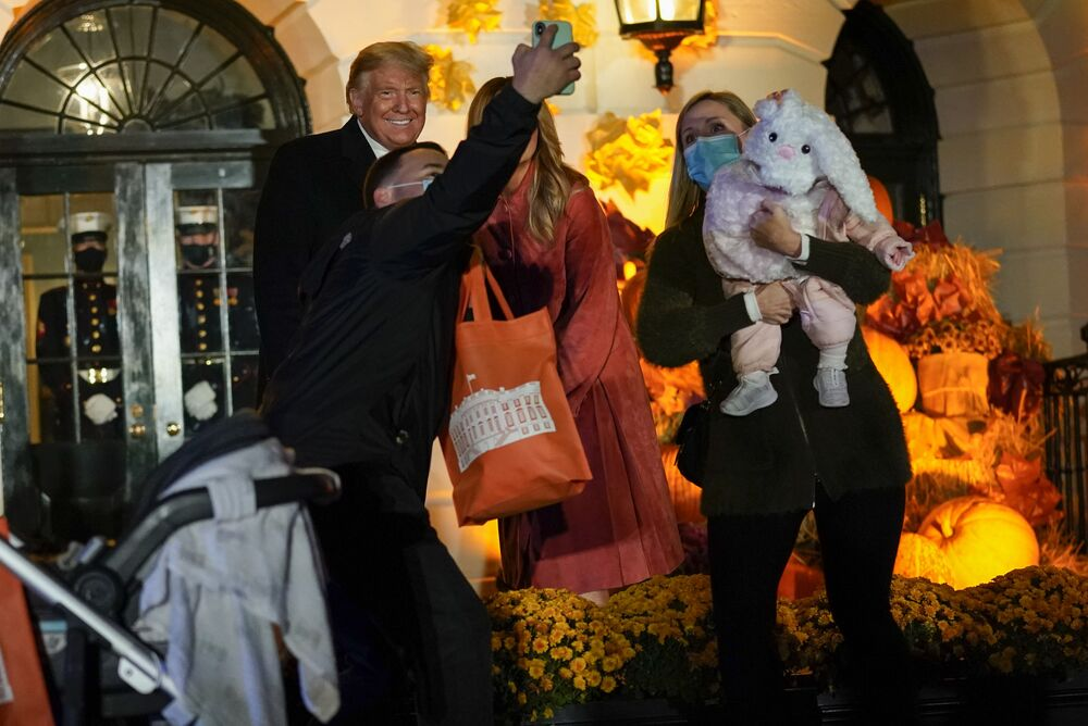 President Donald Trump and first lady Melania greet trick-or-treaters on the South Lawn during a Halloween celebration on 25 October 2020 in Washington.