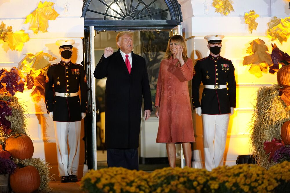 President Donald Trump and first lady Melania Trump greet trick-or-treaters on the South Lawn during a Halloween celebration at the White House on 25 October 2020 in Washington.