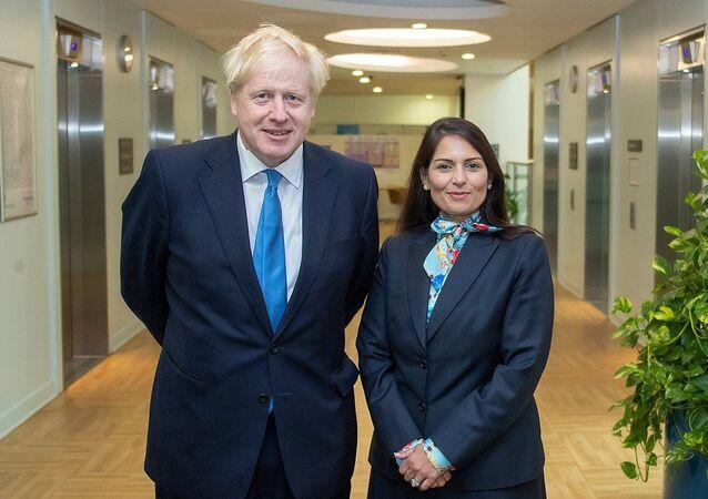 Prime Minister Boris Johnson with Home Secretary Priti Patel in the Home Office.
