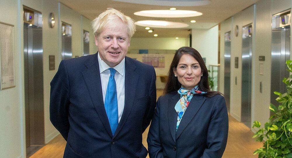 Prime Minister Boris Johnson with Home Secretary Priti Patel in the Home Office