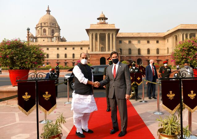 U.S. Secretary of Defence Mark Esper and India's Defence Minister Rajnath Singh shake hands as he arrives to inspect the guard of honour in New Delhi, India October 26, 2020