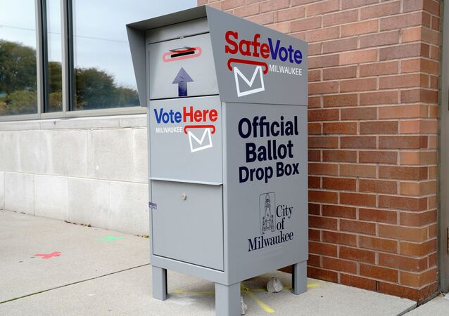 A SafeVote official ballot drop box for mail-in ballots is seen outside a polling site at the Milwaukee Public Library's Washington Park location in Milwaukee, on the first day of in-person voting in Wisconsin, U.S., October 20, 2020.