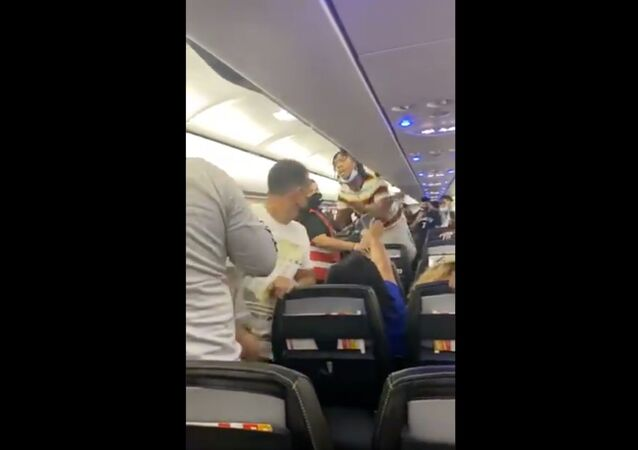 Cellphone footage captures moment passenger aboard Spirit Airlines is apprehended by Puerto RIco's law enforcement officials following a brawl aboard the flight.