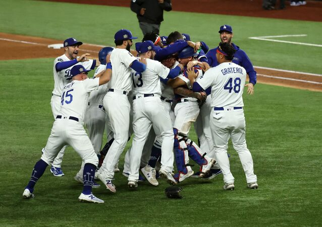 Los Angeles Dodgers players celebrate winning the World Series against the Tampa Bay Rays in Arlington, Texas.