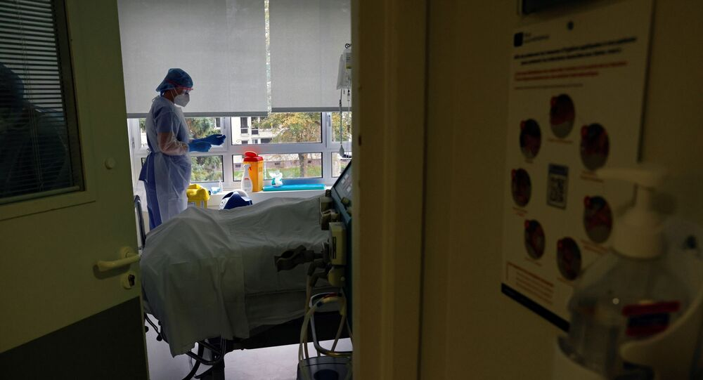 Nurses wearing protective masks and protective suits, work in the Intensive Care Unit (ICU) where patients suffering from the coronavirus disease (COVID-19) are treated at the Le Bois private hospital in Lille, France, October 28, 2020