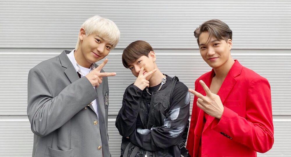 EXO's Chanyeol, Baekhyun and Kai are posing together