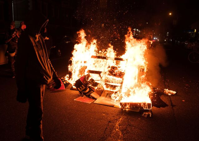 Fire burns as demonstrators clash with riot police during a rally after the death of Walter Wallace Jr., a Black man who was shot by police in Philadelphia, Pennsylvania, U.S., October 27, 2020