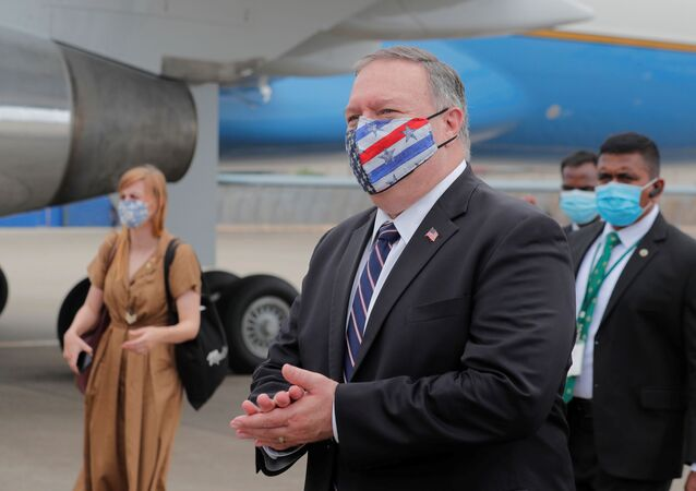 U.S. Secretary of State Mike Pompeo walks to board an aircraft to leave for Maldives, in Colombo, Sri Lanka October 28, 2020.