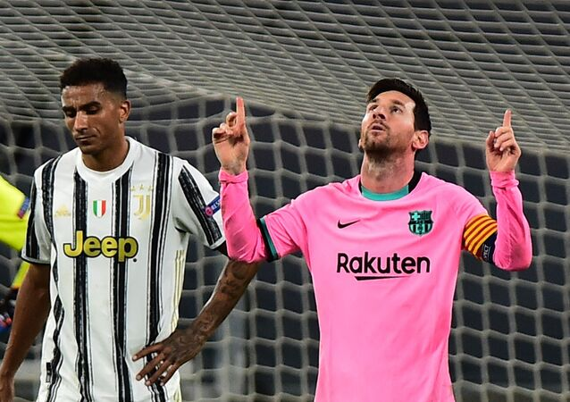 Soccer Football - Champions League - Group G - Juventus v FC Barcelona - Allianz Stadium, Turin, Italy - 28 October 2020  Barcelona's Lionel Messi celebrates scoring their second goal