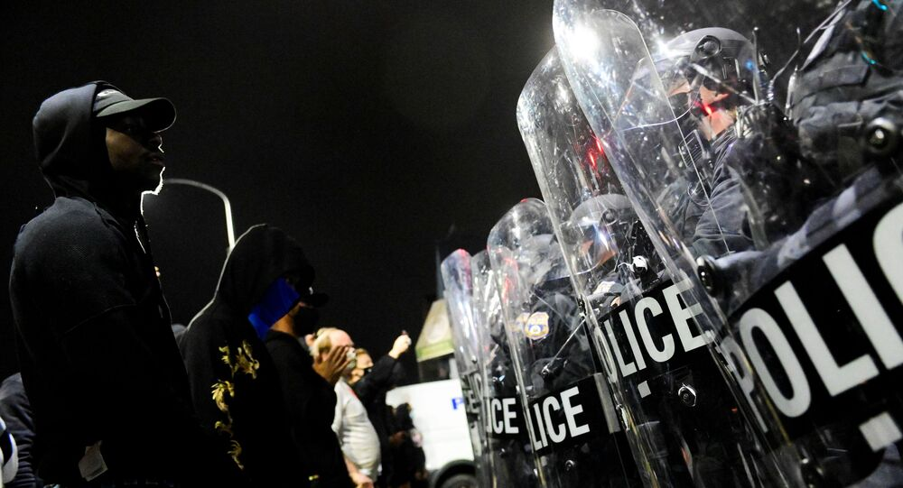 Demonstrators clash with riot police during a rally after the death of Walter Wallace Jr., a Black man who was shot by police in Philadelphia, Pennsylvania, U.S., October 27, 2020