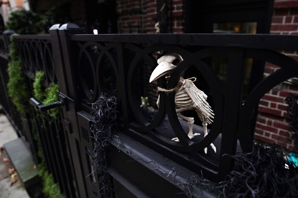 A bird's skeleton is placed outside a house in New York's Upper East Side as part of Halloween celebrations.