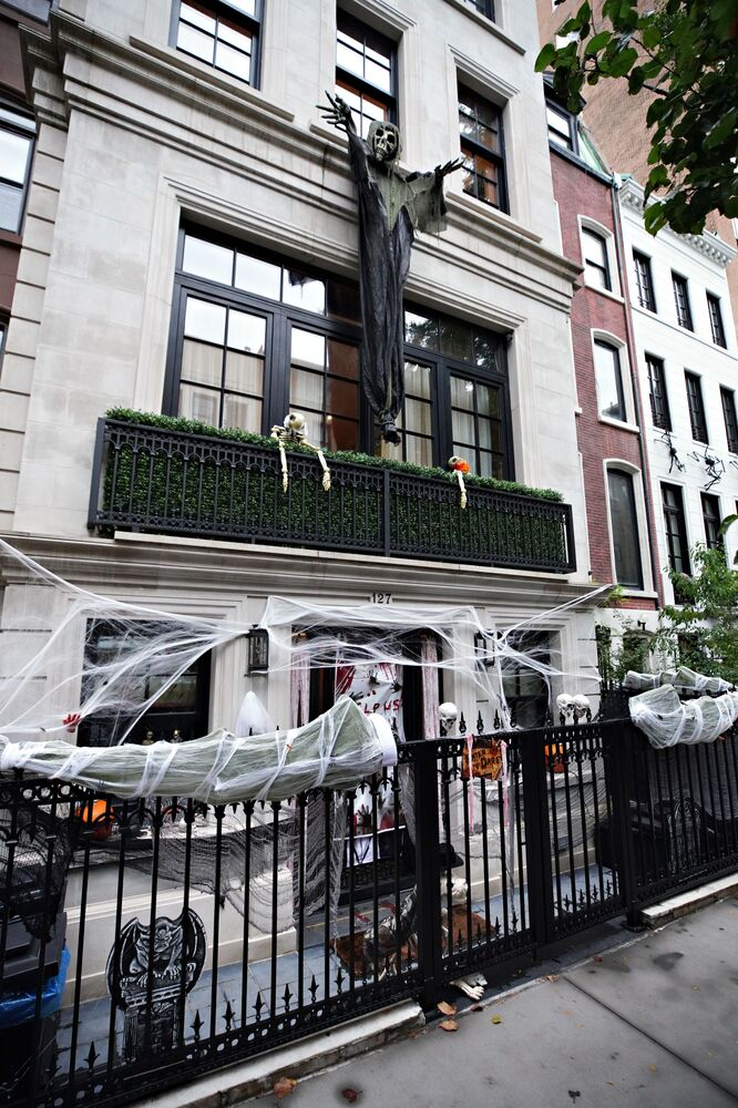 A balcony in New York City is decorated for Halloween.
