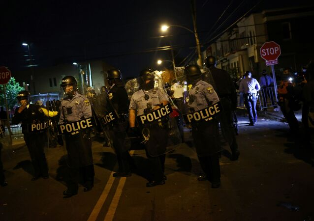 Police officers stand guard outside a police station after the death of Walter Wallace Jr., a Black man who was shot by police in Philadelphia, Pennsylvania, U.S., October 28, 2020.