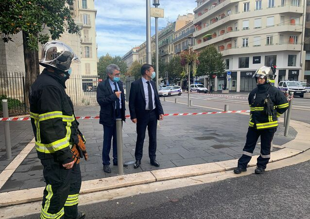 Nice Mayor Christian Estrosi talks to Municipal Police at the site of a knife attack in church in Nice, France, October 29, 2020 in this still image obtained from social media