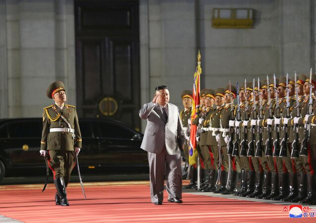 North Korean leader Kim Jong-un salutes as he attends a parade to mark the 75th anniversary of the founding of the ruling Workers' Party of Korea, in this image released by North Korea's Central News Agency on 10 October 2020.