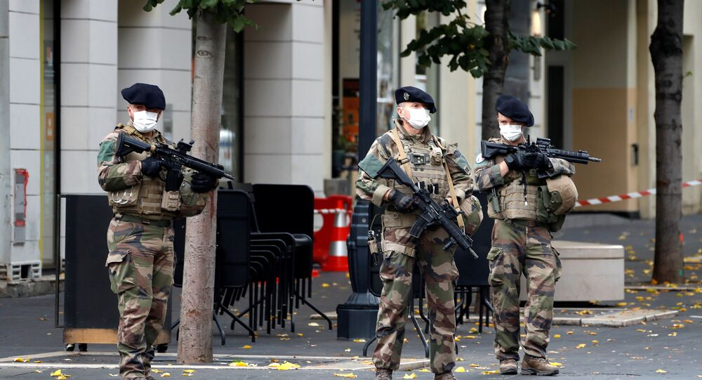 Special forces stand guard near the scene of a reported knife attack at Notre Dame church in Nice, France, October 29, 2020