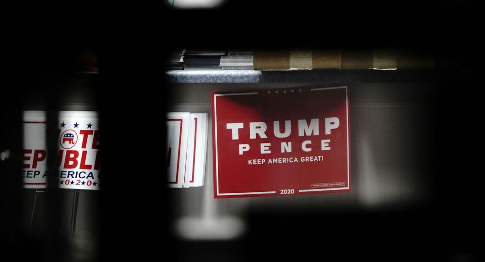 Yard signs supporting US President Donald Trump and Vice President Mike Pence
