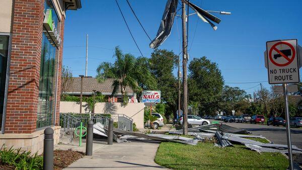 Part of a roof from Liberty Lumber Yard hangs from a power line after Hurricane Zeta swept through New Orleans, Louisiana, U.S., October 29, 2020. - Sputnik International