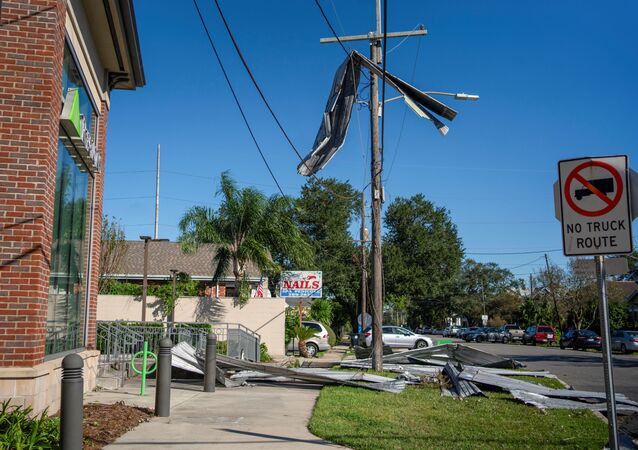 Part of a roof from Liberty Lumber Yard hangs from a power line after Hurricane Zeta swept through New Orleans, Louisiana, U.S., October 29, 2020.